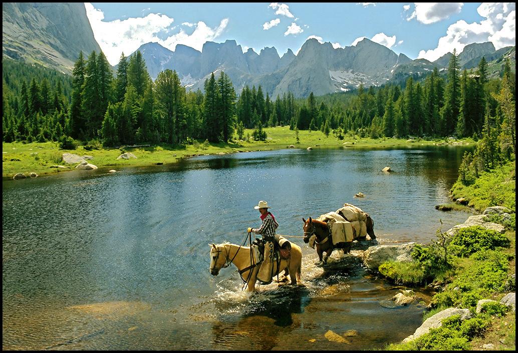 "Raymond Gehman, ""Park Ranger Jim Allen Crossing The Wind River"", Yellowstone National Park, Wyoming"