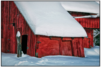 Red, snow-covered barn in Pennsylvania
